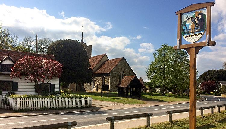 Roydon village sign and church.