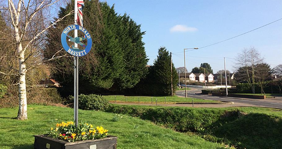 North Weald Village sign in the centre of the village