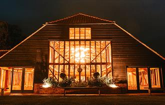 Night view of the Essex Barn wedding venue at Blake Hall Ongar