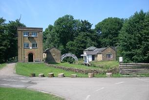 Wildlife Tower, footbridge and canal-side building at the Royal Gunpowder Mills Waltham Abbey.
